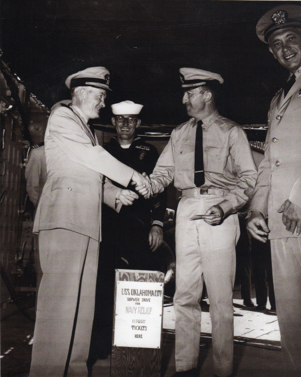 Lt. John Gilhuly receives a hearty handshake from Capt. Mugg